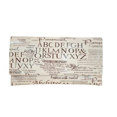Plic din piele naturala imprimeu ziar alb
